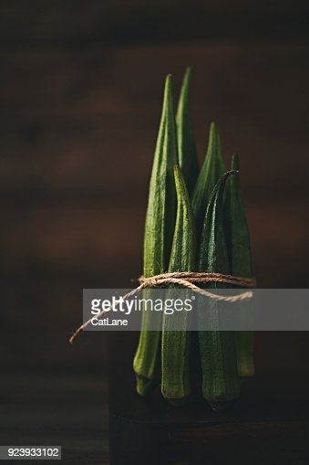 Still life of bundled okra shot in dark moody light