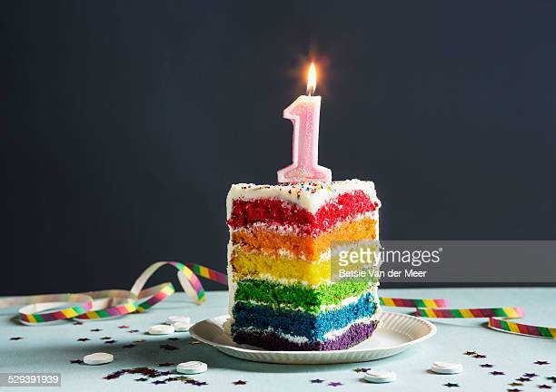 still life of cake with candle number 1 on top. - birthday cake stock photos and pictures
