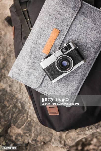 Still life of camera on laptop case