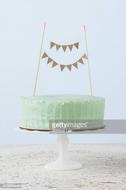 Still life of celebration cake decorated with flag bunting