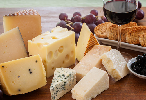 Still life of cheeses and wine 1041757862