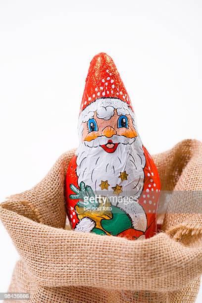 still life of chocolate santa claus in sack