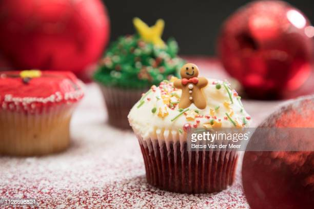 still life of christmas decorated cupcakes. - cake stock pictures, royalty-free photos & images