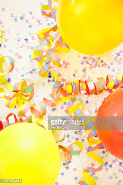 still life of colorful confetti, balloons  and paper streamers for party decoration, backgrounds - streamer stock photos and pictures