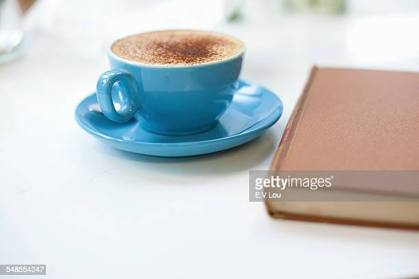 Still life of cup of coffee and book