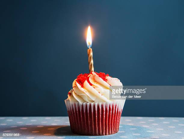 still life of cupcake with one candle. - happy birthday stock pictures, royalty-free photos & images