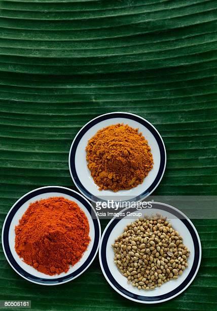 Still life of curry and masala powder on a banana leaf