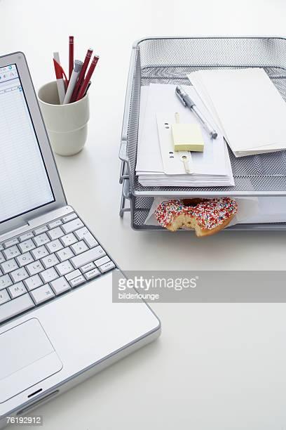still life of donut in tray on office desk