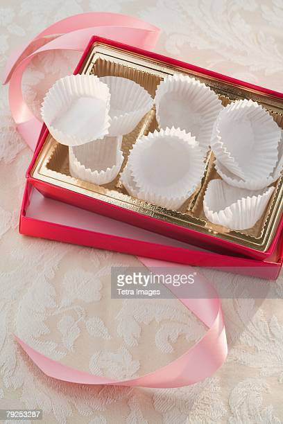 still life of empty box of chocolates - candy wrapper stock photos and pictures