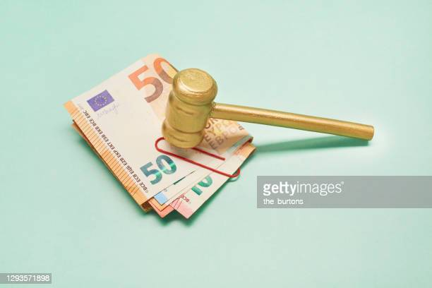 still life of euro banknotes and golden judge's hammer (gavel) on green background - bid stock pictures, royalty-free photos & images
