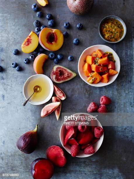 still life of food bowls and fresh fruit, overhead view - 果物の盛り合わせ ストックフォトと画像
