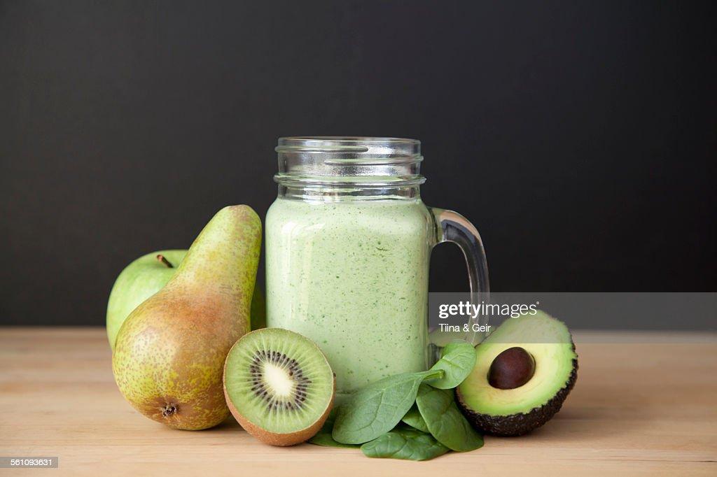 Still life of fresh kiwi, pear and avocado smoothie : ストックフォト