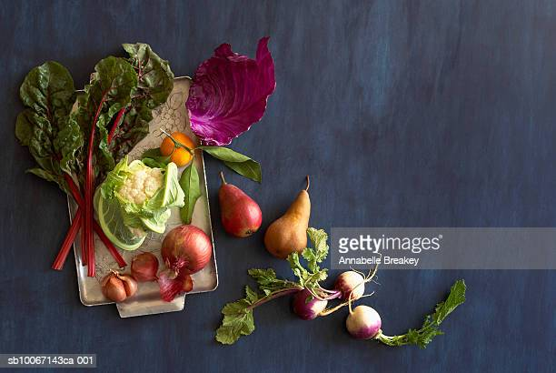 Still life of fruits and vegetables on blue background