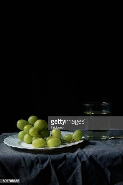 still life of grapes and glass of wine - stilleven stockfoto's en -beelden