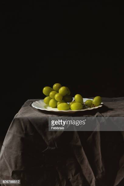 Still life of grapes with window light