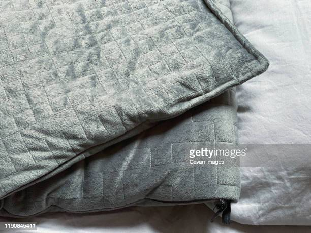 still life of gray, weighted, blanket in bedroom - blanket stock pictures, royalty-free photos & images