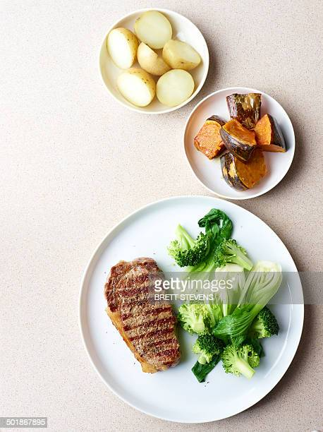 Still life of grilled steak with healthy vegetable sides