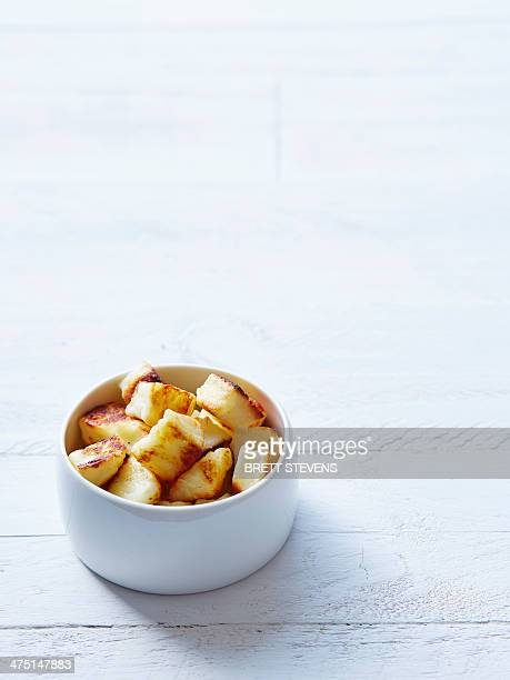 still life of haloumi croutons in a bowl - crouton stock photos and pictures
