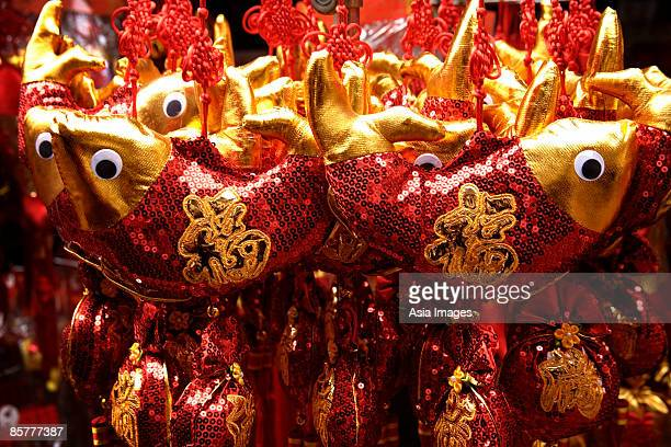 Still life of hanging decorations of fish with Chinese character for fortune
