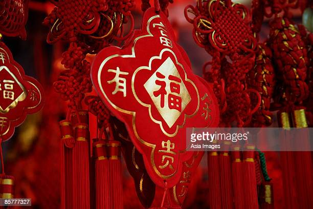Still life of hanging decorations with Chinese character for fortune
