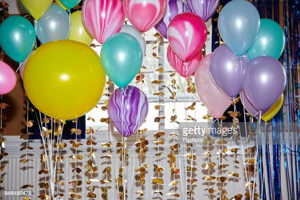 still life of helium balloons - happy birthday stock pictures, royalty-free photos & images