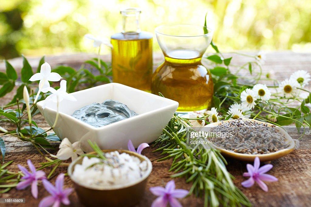 Still life of herbs, massage oil, mud mask, rosemary, salt : Stock Photo