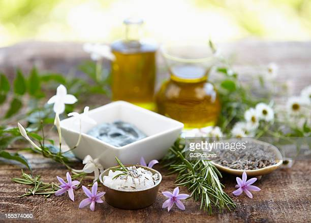 Still life of herbs, massage oil, mud mask, rosemary, salt
