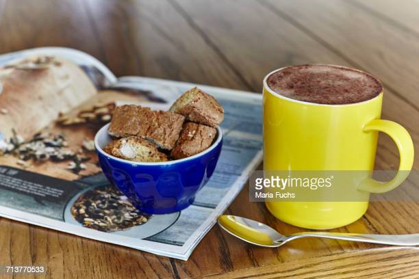 still life of hot chocolate with sweet snack in bowl - food journal stock-fotos und bilder