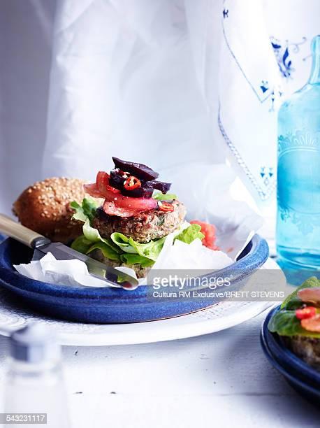 Still life of kangaroo burger with salad