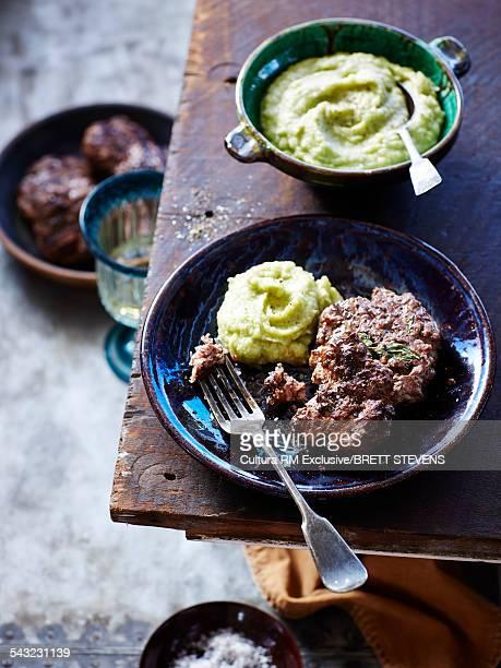 Still life of lamb and mint patties with cauliflower puree