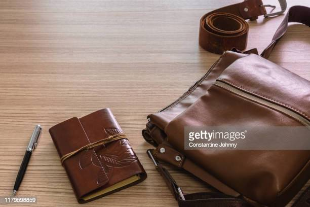 still life of laptop and notebook on wooden work desk - brown purse stock pictures, royalty-free photos & images