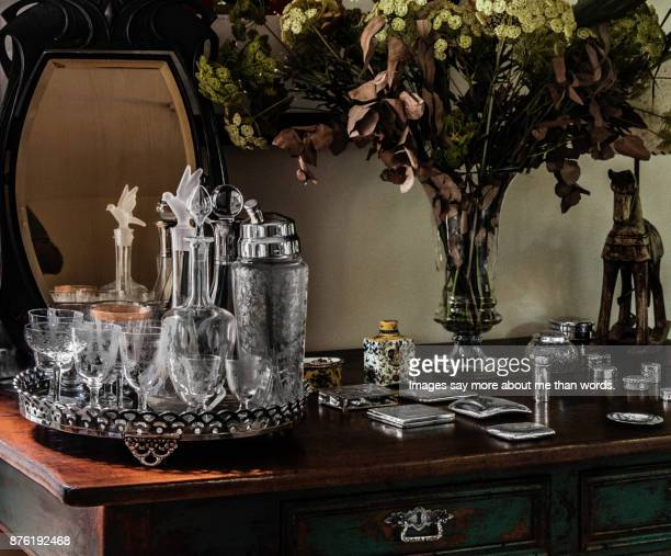 Still life of living room sideboard with various objects of decoration.
