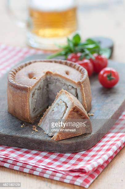 Still life of melton mowbray pork pie on chopping board