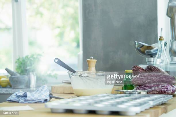 still life of mixing bowl with whisk, and baking tray - cooking utensil stock photos and pictures