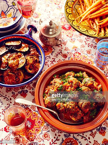 still life of moroccan kefta meatballs with eggplant and carrots - moroccan culture stock photos and pictures