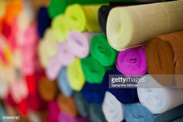 Still life of multi colored crepe paper rolls