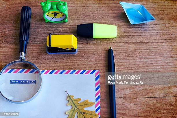 Still life of office supplies and writing accessories over wooden background. Overhead and copy space.