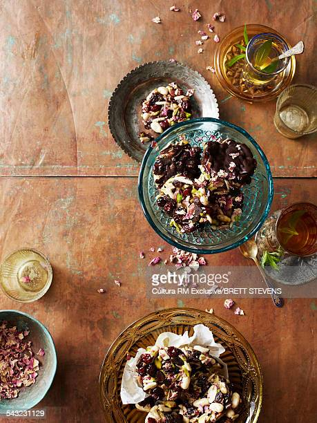 Still life of persian florentine biscuits with dark chocolate and pistachios
