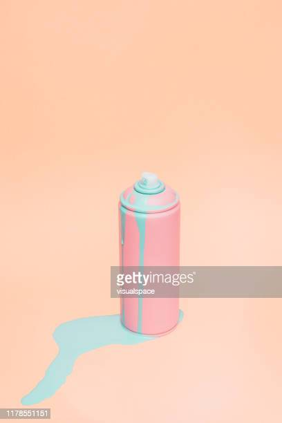 still life of pink spray can - pastel stock pictures, royalty-free photos & images