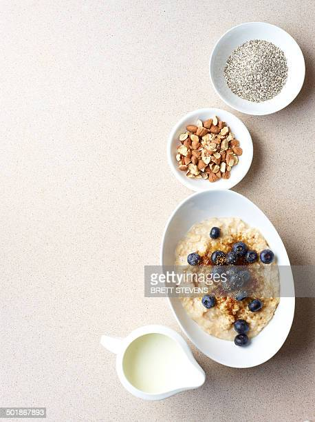 Still life of porridge with fruit and nuts