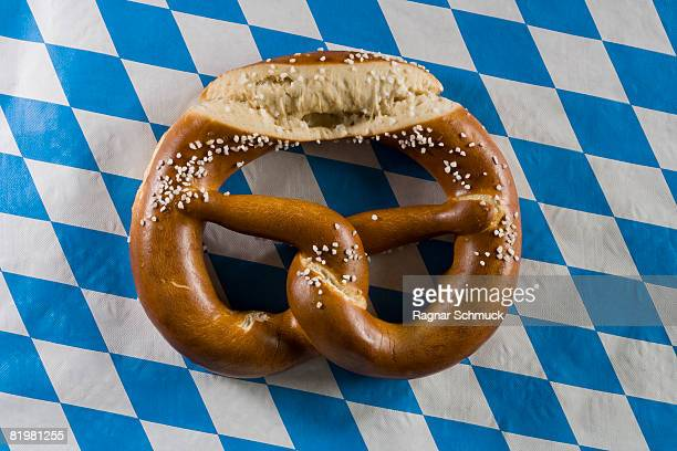 Still life of pretzel on a stereotypical German blue checked tablecloth
