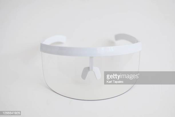 still life of protective face shield on a white background - フェイスシールド ストックフォトと画像