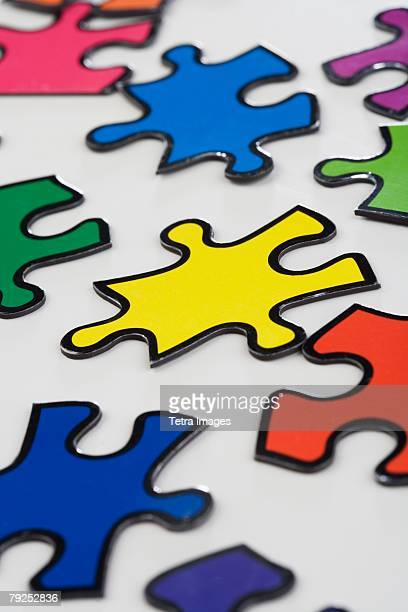 still life of puzzle pieces - things that go together stock pictures, royalty-free photos & images