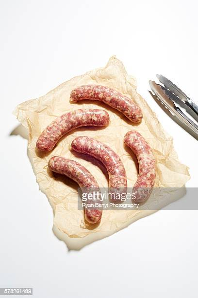 Still life of raw italian sausages on brown paper