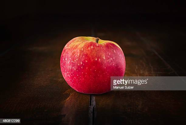 Still life of red apple on rustic wooden table