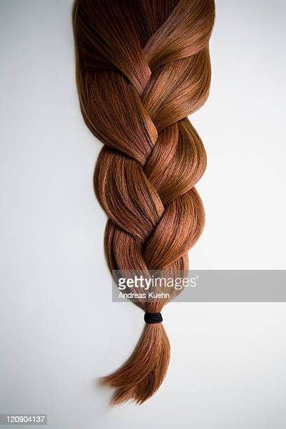 still life of red haired braid on white background - braided stock pictures, royalty-free photos & images