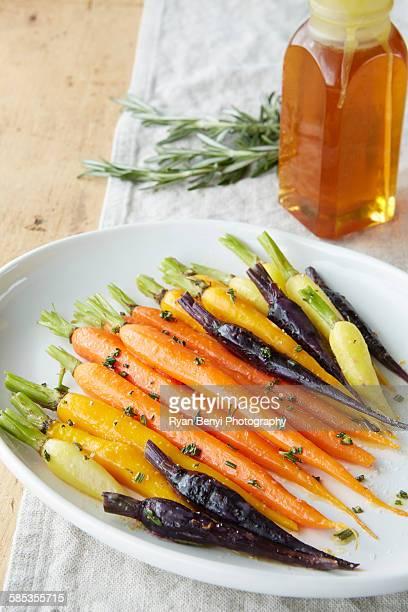 Still life of roasted baby carrots with a rosemary and honey glaze