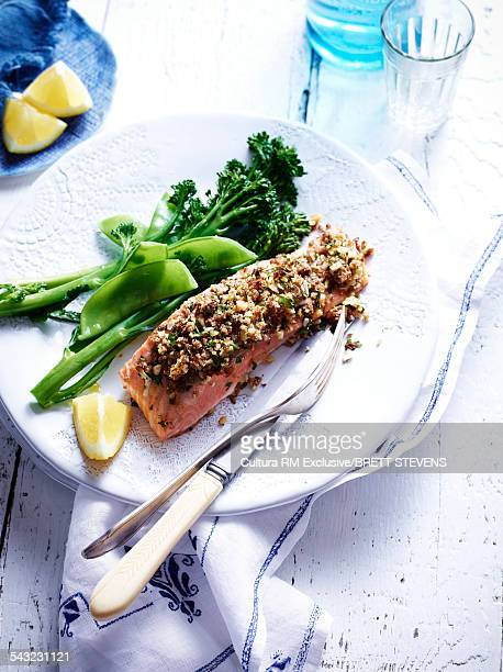 Still life of salmon with a feta cheese and walnut crust