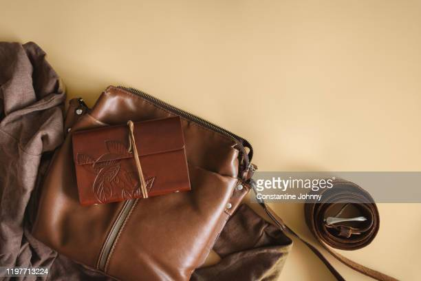 still life of satchel bag and personal diary - leather purse stock pictures, royalty-free photos & images