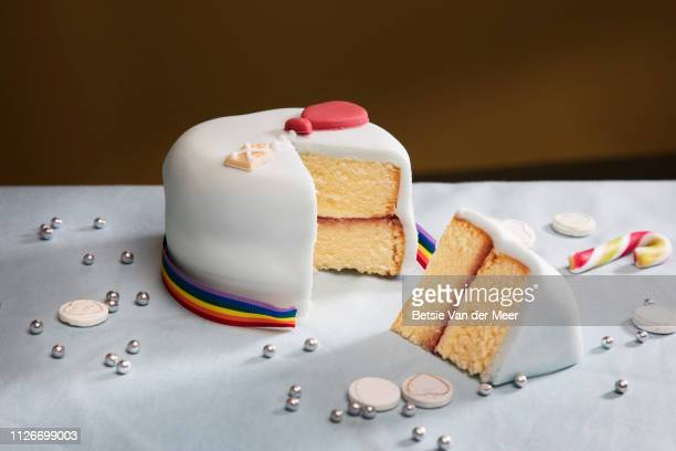 still life of  sliced birthday cake. - icing stock pictures, royalty-free photos & images